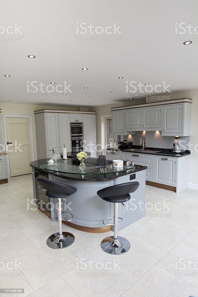 A modern grey kitchen ready for cooking royalty-free stock photo
