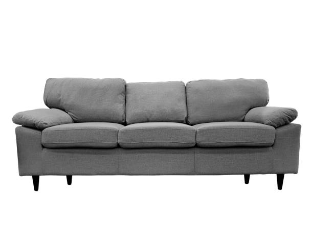 Modern grey sofa Front view of a fabric modern grey sofa isolated on a white background. sofa stock pictures, royalty-free photos & images