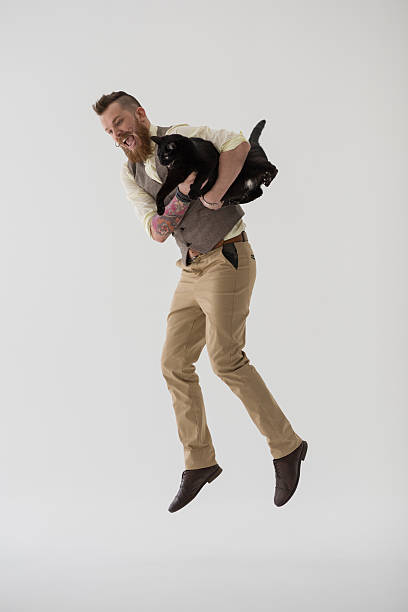 Modern groom jumping with his cat picture id619504502?b=1&k=6&m=619504502&s=612x612&w=0&h=ikygaviphp56nrbpzcstfeakb8af4eqalc7ukgerzfi=