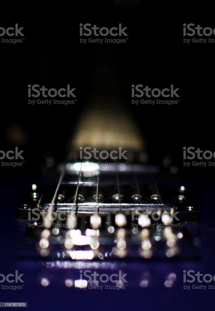 Electric guitar closeup on black background.