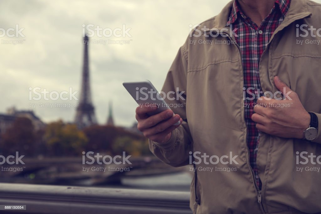 Modern guy using cellphone in the European city. stock photo