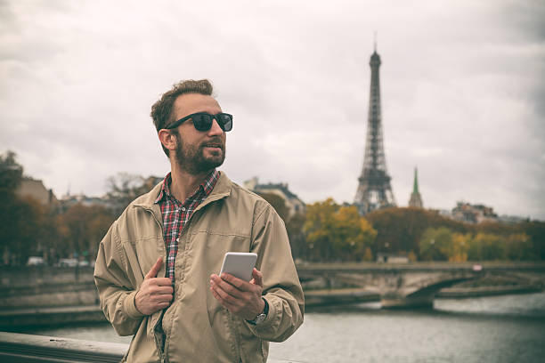 Modern guy using smartphone in the European city. stock photo