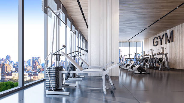 modern gym interior with city view , 3d rendering - health club stock photos and pictures