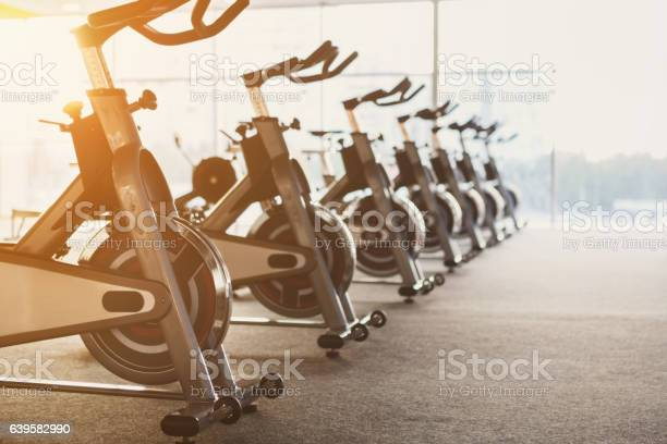 Modern gym interior with equipment fitness exercise bikes picture id639582990?b=1&k=6&m=639582990&s=612x612&h=mrubzyf1csf  d0sz0yjdeqvn iwxmfh3li52182bsq=
