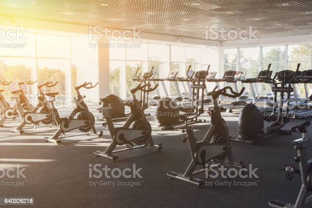 Modern gym interior with equipment fitness exercise bikes picture id640326218?b=1&k=6&m=640326218&s=612x612&h=wq2lmtfyzy5wgd4yv5gnzsv2fv8a2xjm7p jhu jhqi=
