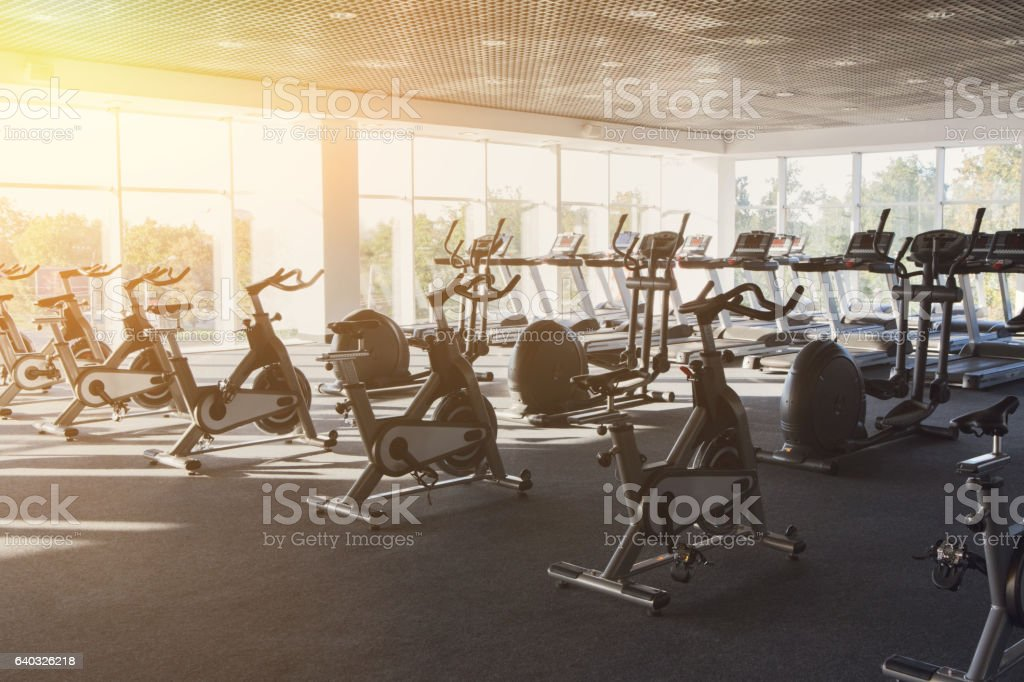 Modern gym interior with equipment, fitness exercise bikes - foto de stock