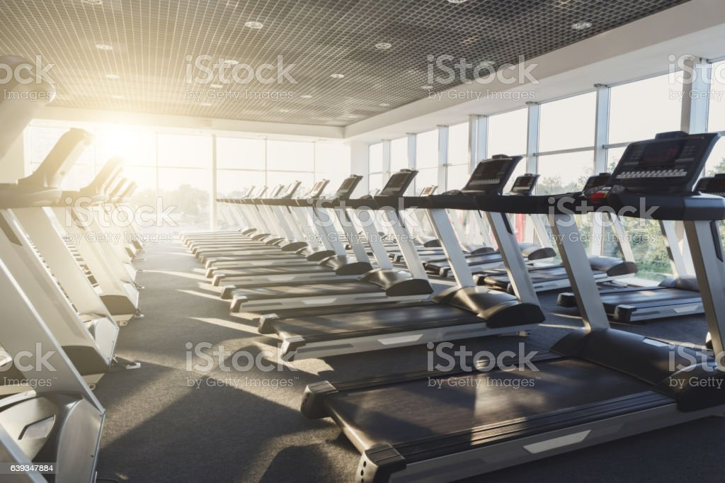 Modern gym interior with equipment, treadmills for fitness cardio training stock photo