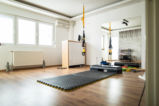 Bright modern gym with exercise equipment
