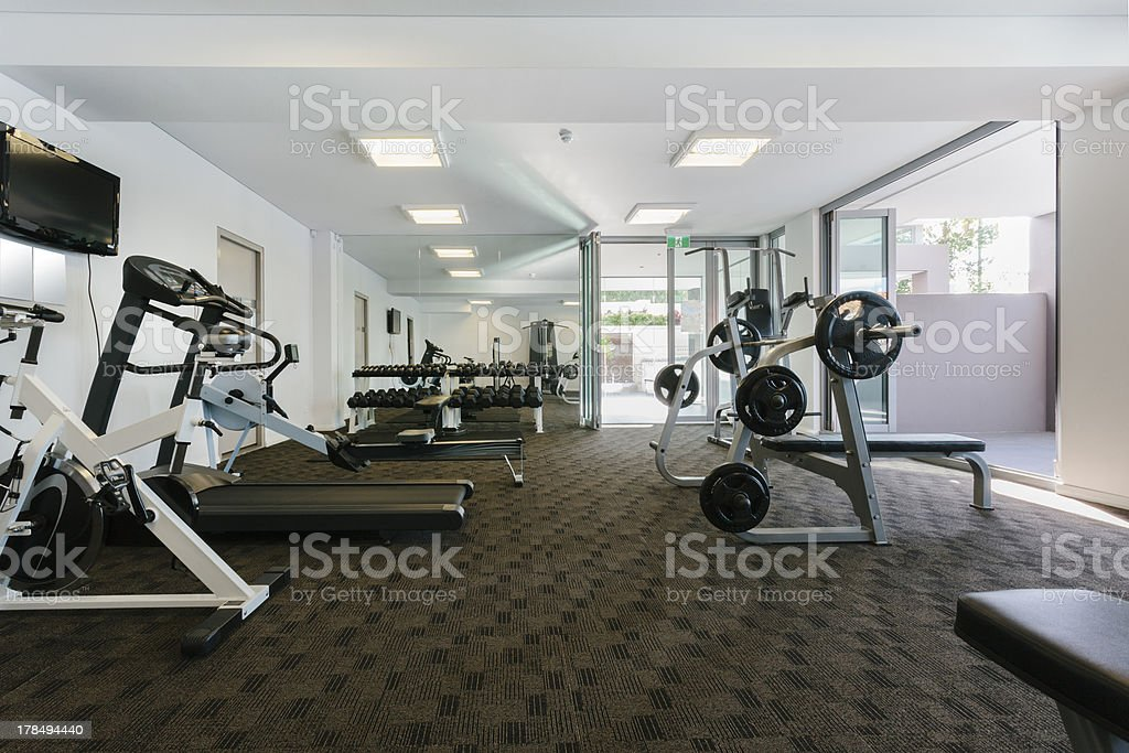 Modern gym with carpet weights stock photo