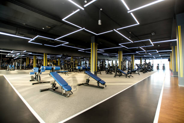 Modern gym with sports equipment Sports equipments for sports and weight training in modern health club training equipment stock pictures, royalty-free photos & images