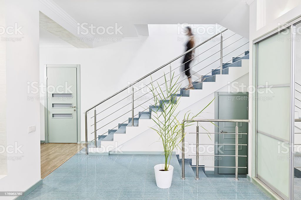 Modern hall interior in minimalism style with stairs stock photo