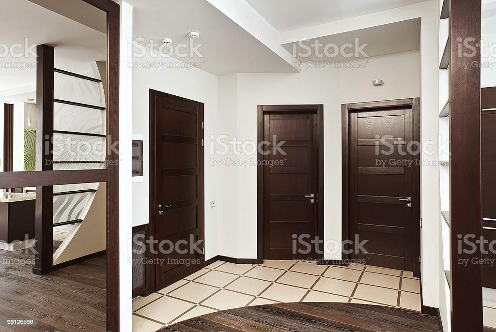 Modern hall interior with many hardwood doors royalty-free stock photo