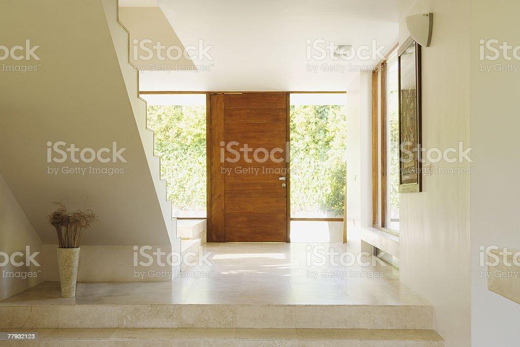 Modern hallway with wooden door stock photo