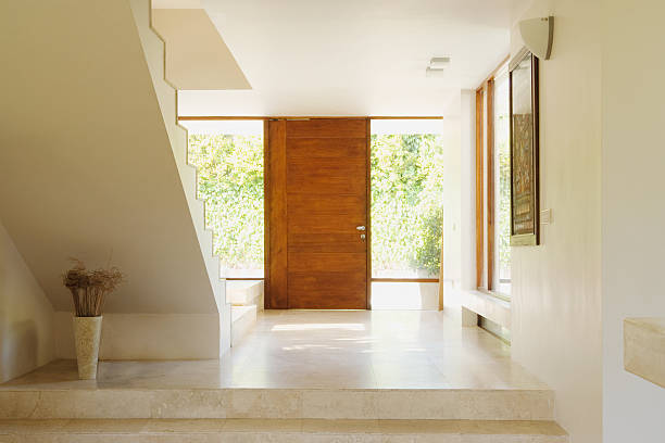 modern hallway with wooden door - entrance stock photos and pictures