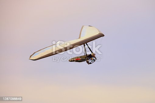 Modern hang glider wing in flight. Extreme action sport.