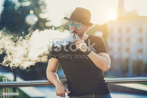 fe8373a5f51 istock Modern happy young man in hat with a beard fun Vaporizers