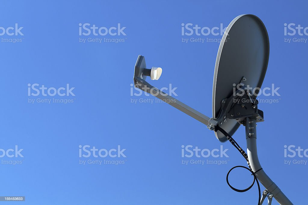 Modern HD Satellite Dish Against A Blue Sky stock photo