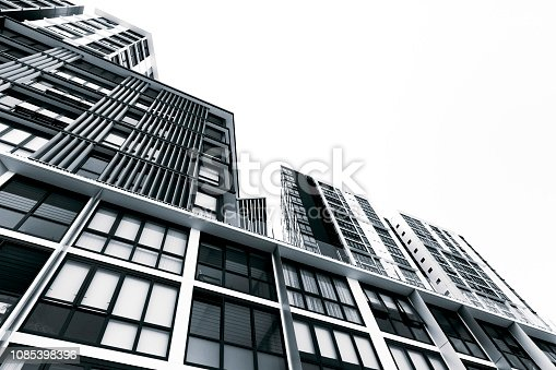 Black and white low angle view of new high rise apartment buildings, sky background with copy space, Wolli Creek, Australia, full frame horizontal composition