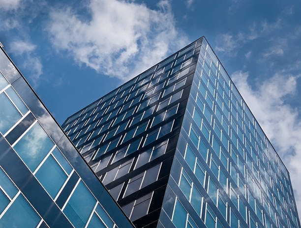 Modern high rise with cloud reflecting windows  right angle stock pictures, royalty-free photos & images
