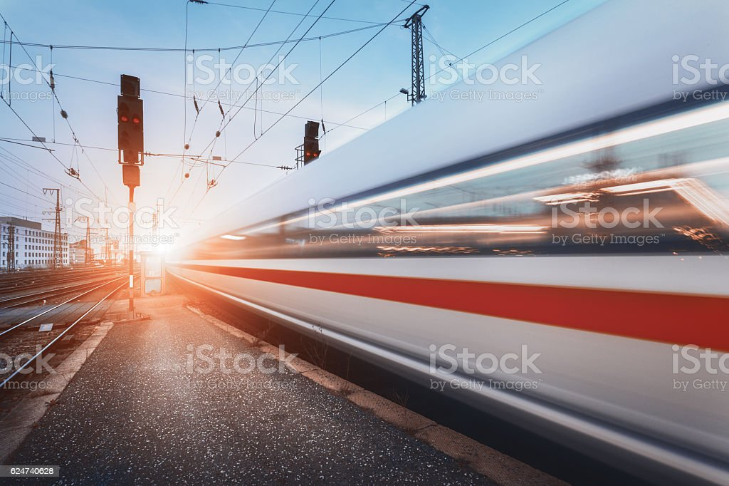 Modern high speed passenger train on railroad in motion stock photo