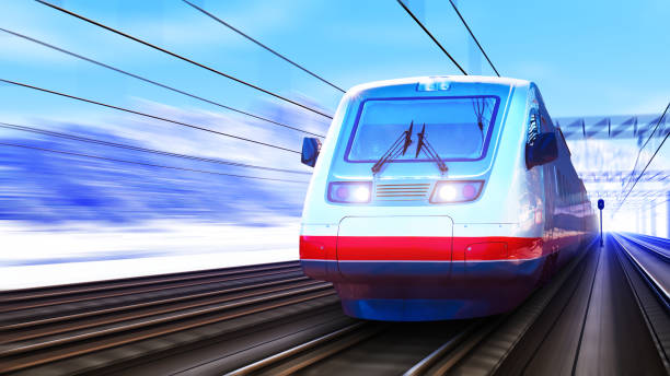 Modern high speed train in winter Creative abstract railroad travel and railway tourism transportation industrial concept: scenic winter view of modern high speed passenger commuter train on tracks with snow and mountains with motion blur effect electric train stock pictures, royalty-free photos & images
