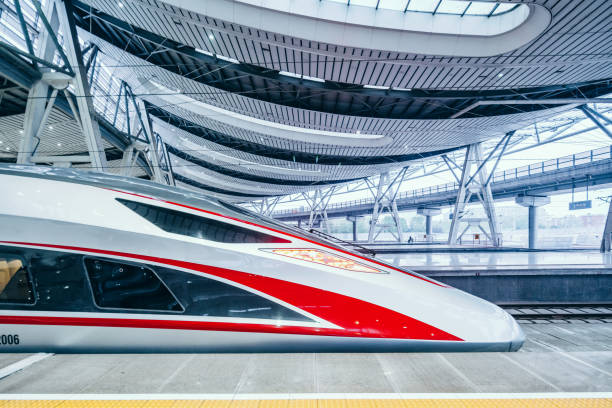 Modern High speed trains in Beijing, China Beijing, China - April 18, 2018: View of Modern High speed Bullet trains in Beijing south train station, China bullet train stock pictures, royalty-free photos & images
