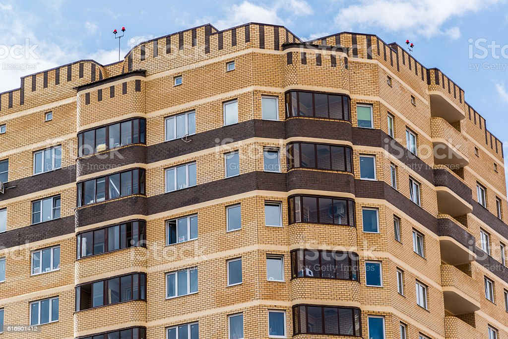 Modern high-rise apartment building made of brick stock photo