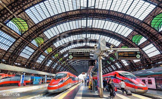 Milan, Italy - May 17, 2017: Modern high-speed trains at the railway Milan Central Station. Industrial landmark and tourist place of Milan. Concept of travel and transport across Milan and Europe.