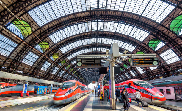 Modern high-speed trains at Milan Central Station Milan, Italy - May 17, 2017: Modern high-speed trains at the railway Milan Central Station. Industrial landmark and tourist place of Milan. Concept of travel and transport across Milan and Europe. railroad station stock pictures, royalty-free photos & images