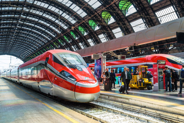 modern high-speed trains at the railway milan central station - milan railway foto e immagini stock