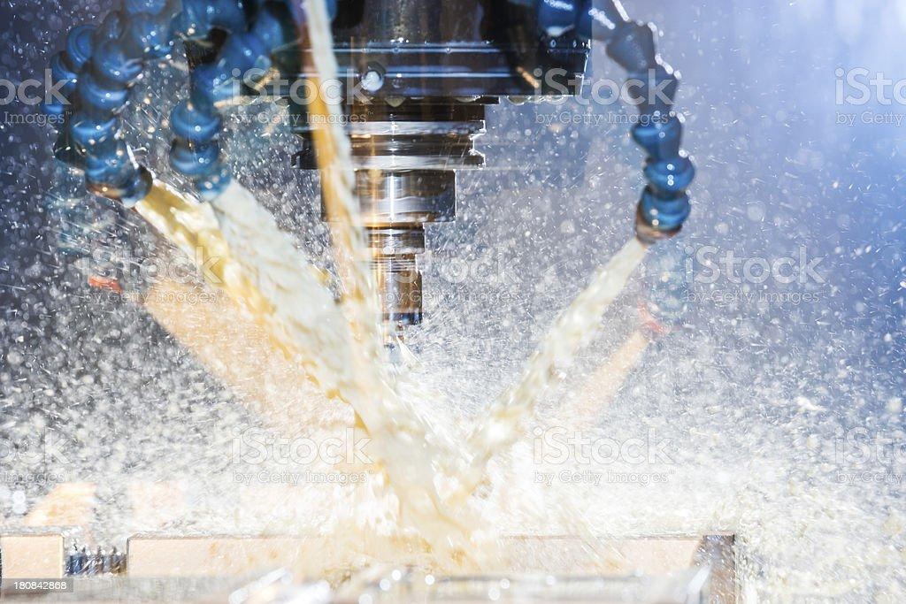 Modern, high-tech, CNC, metal milling machine in use. stock photo