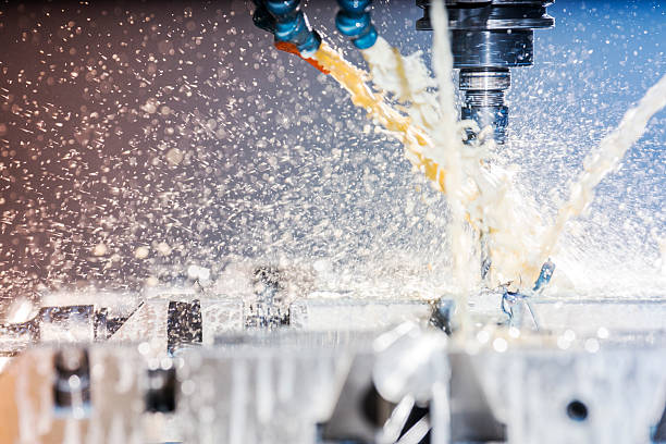 Modern, high-tech, CNC, metal milling machine. A photograph of a modern, high-tech, CNC, metal milling machine in a metal manufacturing plant. metal worker stock pictures, royalty-free photos & images