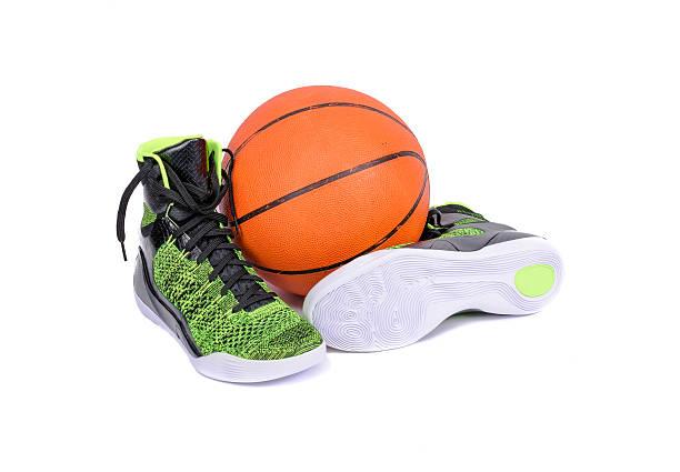 Modern high-top green and black basketball shoe sneaker stock photo