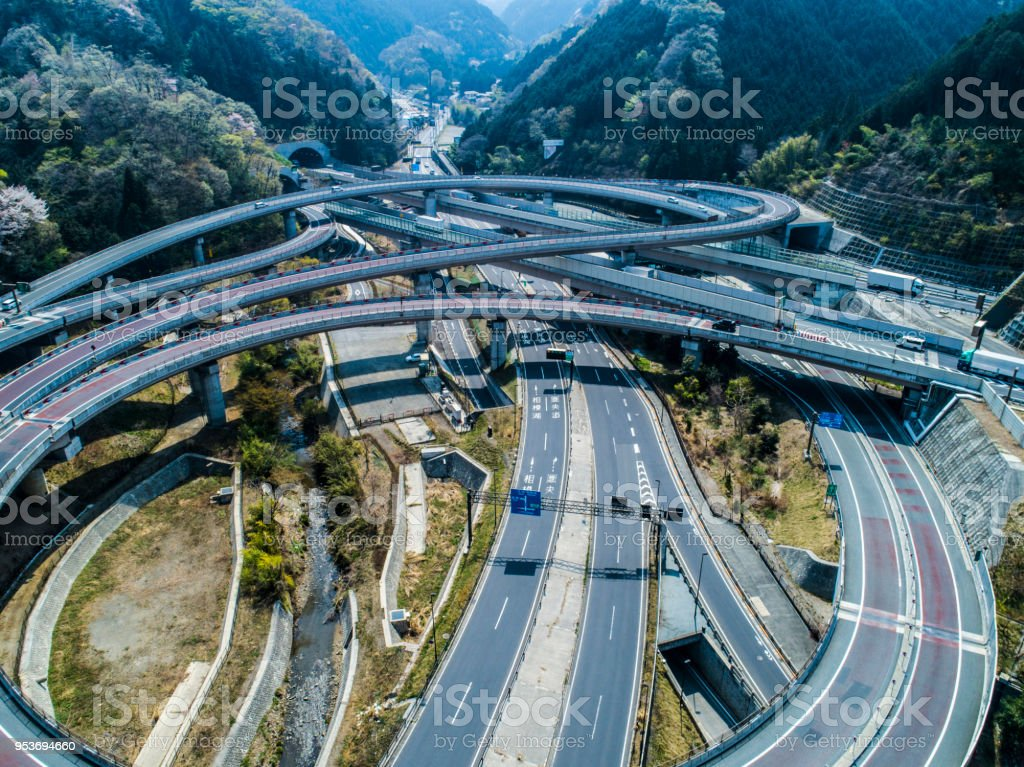 Modern highway in Japan and green mountains stock photo