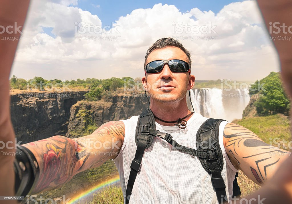 Modern hipster young man taking a selfie at Victoria Waterfalls stock photo