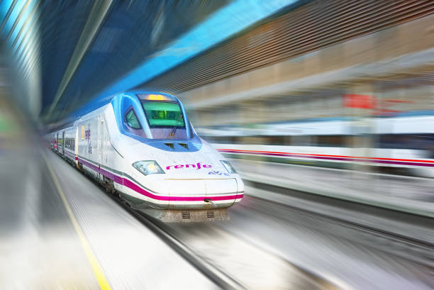 Modern hi-speed passenger train of Spanish Railways Company - Renfe, in  movement (motion). stock photo