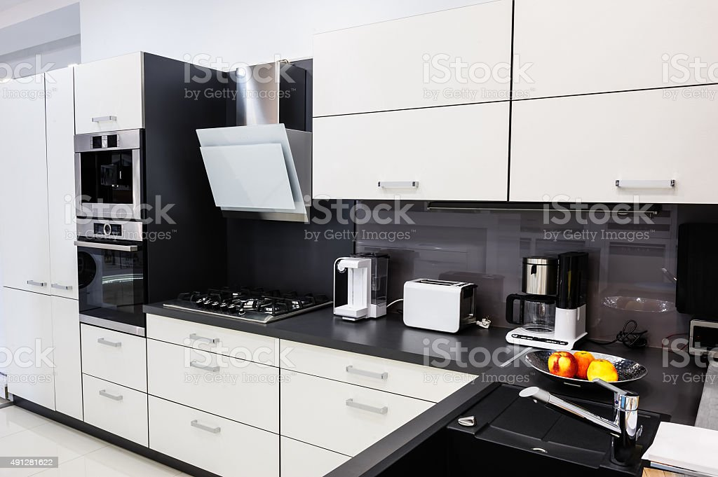 Modern hi-tek kitchen, clean interior design stock photo