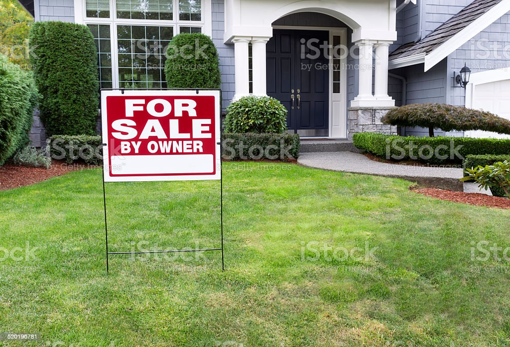 Modern Home for Sale with sign in front yard stock photo