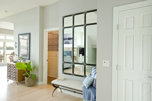 A contemporary home entry hallway foyer with bathroom and interior front door.