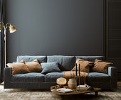 istock Modern home interior mock-up with dark blue sofa, table and decor in living room 1291649034