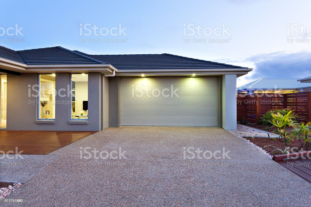 Modern home shot at twilight stock photo
