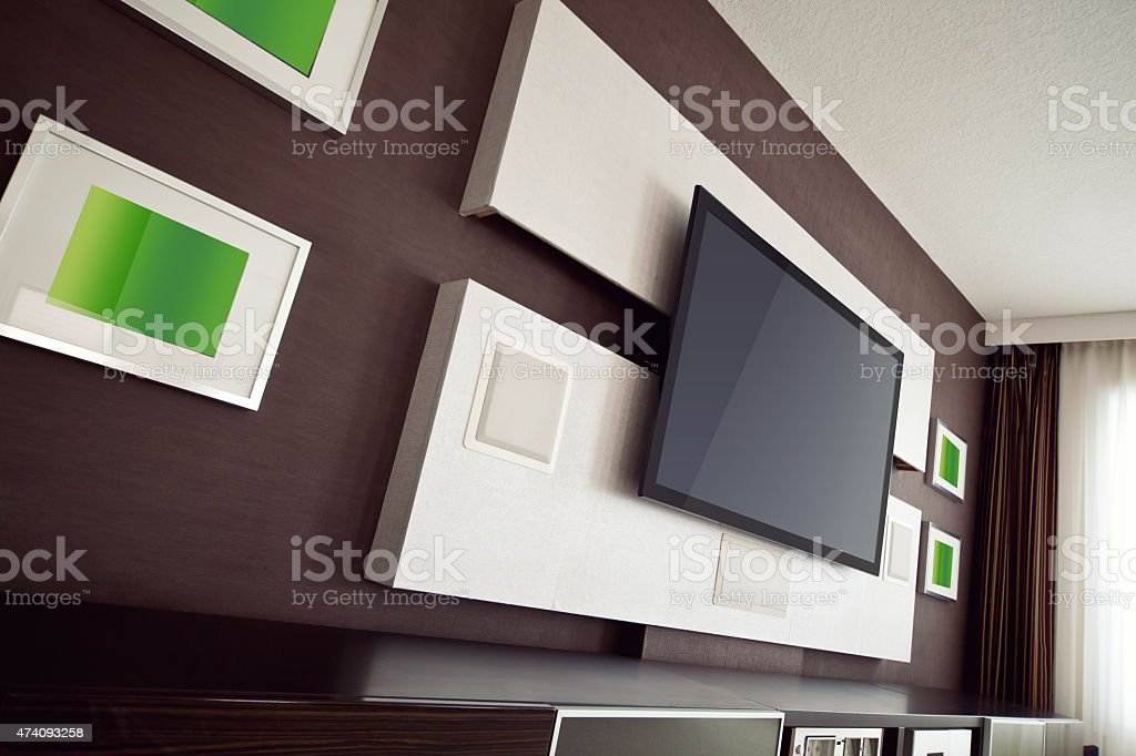 Modern home theater wall treatments with a flat screen TV stock photo