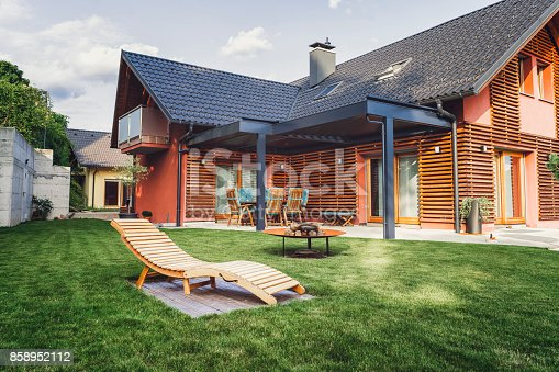 Life in the suburbs, wealthy family, great new house in the country side, wooden material, green color
