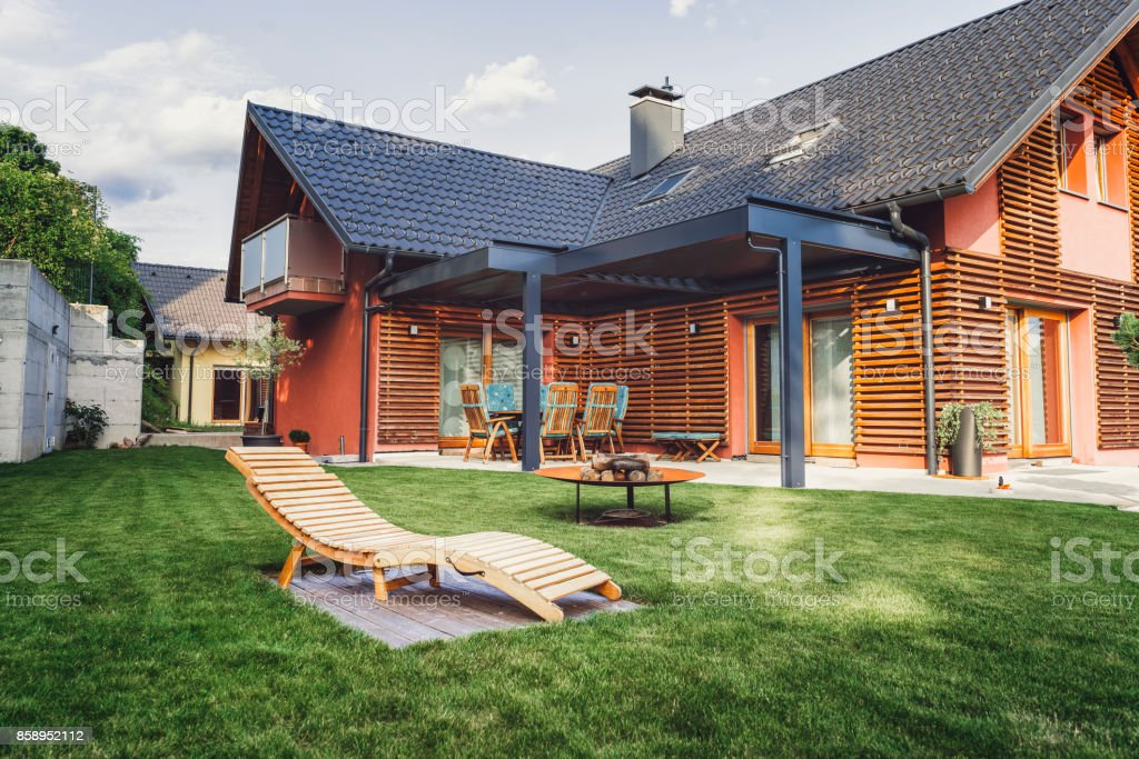 Modern home with back yard stock photo