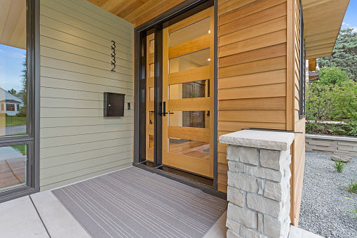 Modern home with glass-paneled front door