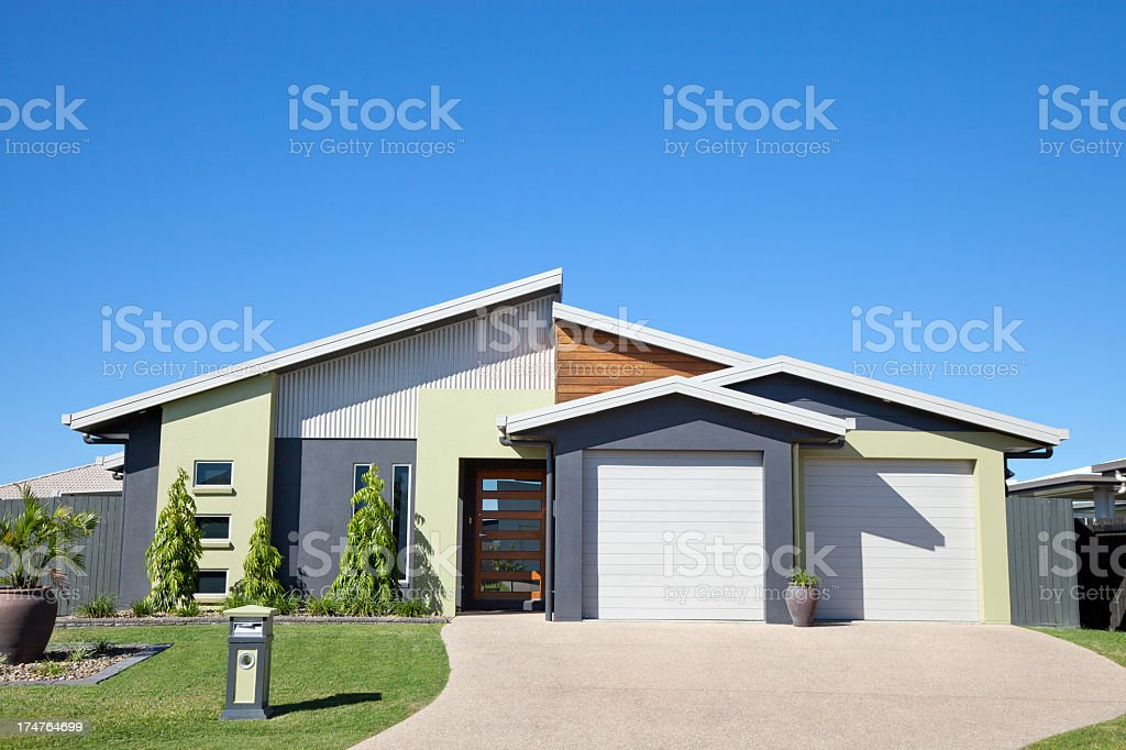 Modern home with two car garage and straight lines stock photo