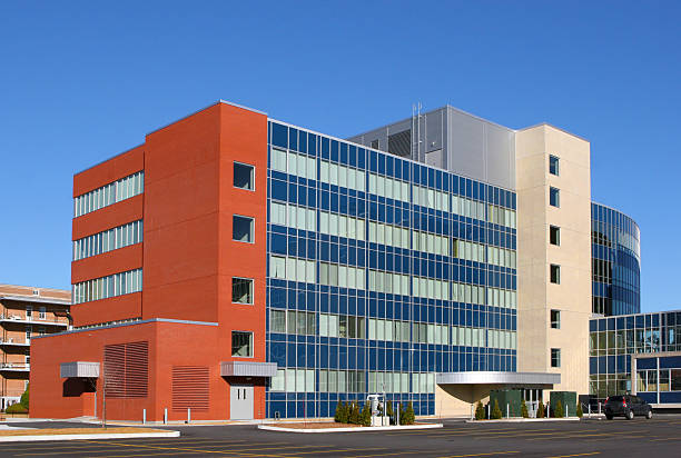 modern hospital building exterior - hospital building stock photos and pictures