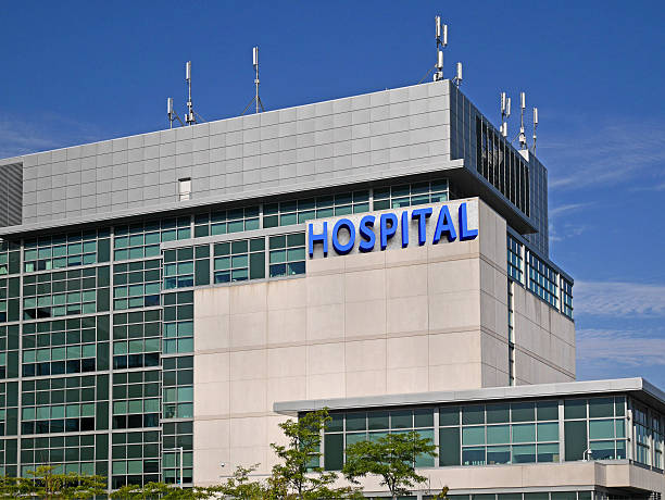 modern hospital building - hospital building stock photos and pictures