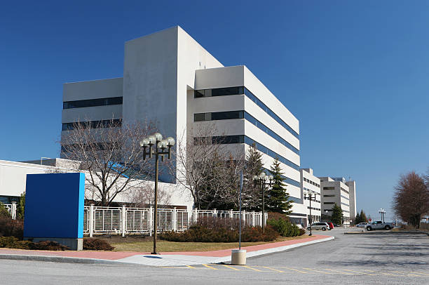 modern hospital building with sign - hospital building stock photos and pictures