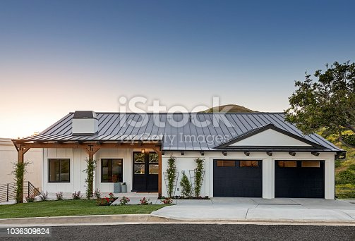 Front photos of a modern home at sunset.